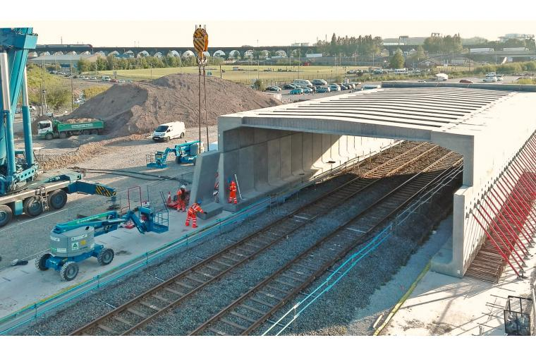 1) The skew-bridge is sited where the main north and southbound carriageways cross a rail freight line
