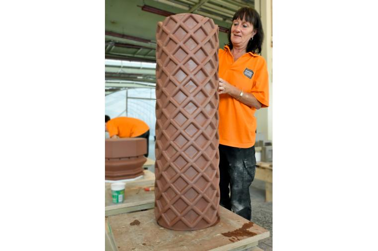 1) Hand finishing architectural terracotta ensures the character of the original piece is replicated as this Tudor chimney pot shows