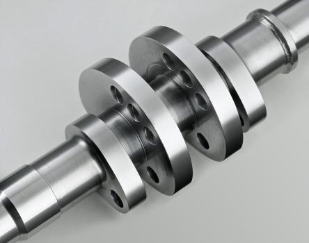 3) A camshaft after surface finishing in an Otec stream finishing machine