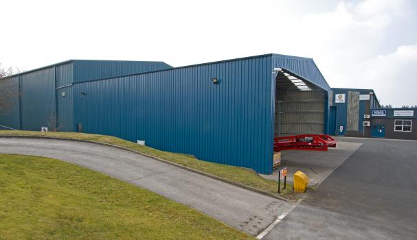 3) The light weight permanent steel extension is clad in ocean blue panels and matches the existing warehouse