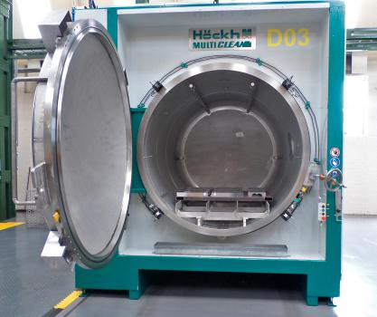 2) The Hockh washer uses perchloroethylene, a solvent commonly used by dry cleaners, for effective cleaning on a closed process where solvent is recovered and reused