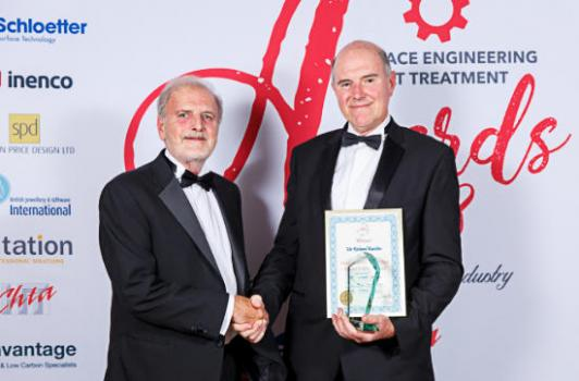 1) Richard Burslem (right) receiving the award from Alin Hick. (Image courtesy of Bandele Zuberi - high resolution images available to purchase http://clients.bandelezuberi.com/gallery/sea-awards-2018/)